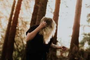 Woman distressed in a forest